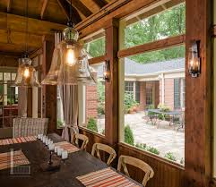 screened porch with exposed rafter ceilings and lighting