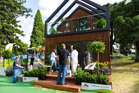 tiny house news. People Standing Outside The Tiny House Display Home At Flower Show. News U