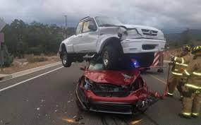 Pick-up truck lands on top of car in horrific car crash