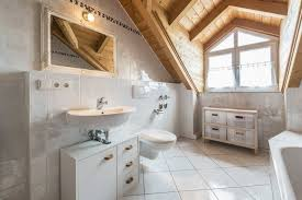 white bathroom designs. a white bathroom with gorgeous natural wood ceilings. the glossy tile is pervasive throughout designs o