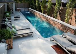 Swimming Pool : Long Sleek Swimming Pool Designs For Small Backyards With  Grey Lounge Chairs Also Exposed Brick Stone Garden Edging Also Small  Waterfall ...