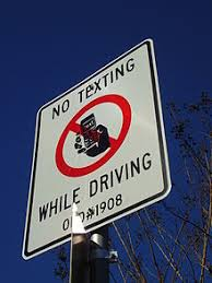 texting while driving a sign in west university place texas greater houston advising drivers that they are not allowed to text