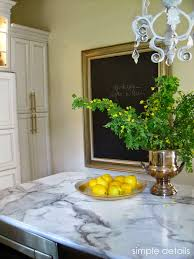 calacatta marble kitchen waterfall: it has lived up to the durable easy to maintain stain and impact resistant claims weuve spilled red wine mustard bbq sauce red sauce paint nothing