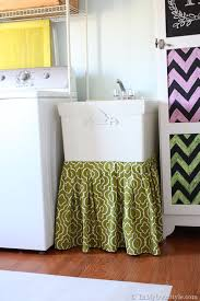 i accomplished both of these created storage and added a bit of pretty when i made a fabric skirt for the functional but plain utility sink in my