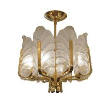 brass eight arm chandelier with upright frosted glass leaf shades chandeliers pendants john salibello