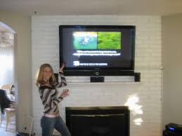 hanging a flat screen tv over a gas fireplace stunning adorable how to hide tv wires over brick fireplace best