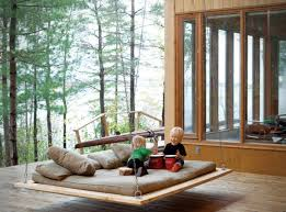 ... Simple Barnwood hanging bed for outdoors