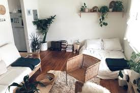 small apartment living room furniture. Best Studio Apartments Images On Small Many Plants Sit Atop Window Sills And Every Flat Surface That The Room Apartment Living Furniture