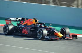 The new f1 car features a simpler front wing and a rear wing designed to push the aerodynamic wake up and over the car following behind. Formula One Car Wikipedia