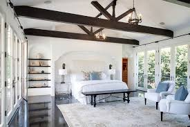 Vaulted ceiling wood beams Living Room White Bedroom With Dark Wood Beam Ceiling Decorpad White Bedroom With Dark Wood Beam Ceiling Transitional Bedroom