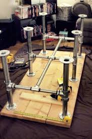 Iron pipe table legs with table top This could work for a work bench or a  dining room table!