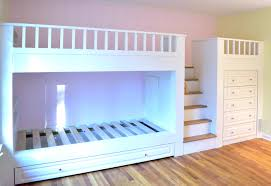 Bunk beds with dressers built in Stunning The Central Staircase With Coordinating Oak Treads Provide Access To The Top Bunk And Play Area Above With Hidden Storage Area Under The Stairs Stuart Home Improvement Llc Builtin Kids Bunk Beds Dresser Play Area Stuart Home