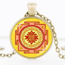 yellow metal sri yantra pendant