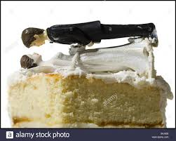 Wedding Cake Visual Metaphor With Figurine Cake Toppers Stock Photo