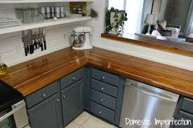 transitional style kitchens with solid wood butcher block countertops wooden magnetic cutlery rack and side kitchen shelves wooden mug rack