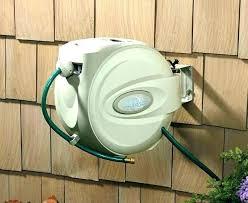 wall mounted garden hose reel marvelous mount swivel retractable heavy duty re pipe bracket liberty top