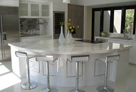 maple cabinets stained with clear glass decorative inserts giallo cream granite countertops