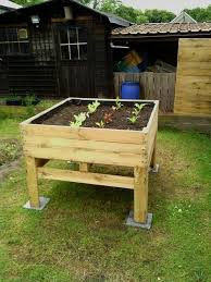 Amazing wooden garden planters ideas try Pallet Gardenhouzcom 51 Stunning Wooden Garden Planters Ideas Try