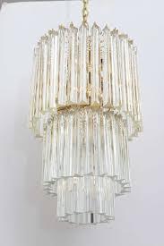 gorgeous chandelier featuring three tiers of handblown triedri three sided glass prisms