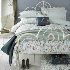 shabby chic bedding sets a romantic atmosphere in a stylish bedroom