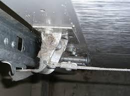 cable operated garage door latch