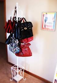 Coat And Bag Rack 100 LifeChanging Ways to Organize Your Purses Closetful of Clothes 69