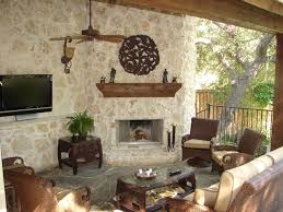 elegant patio photo in dallas with a fire pit and a roof extension