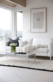this picturesque living room with a white faux fur throw sofa cushion