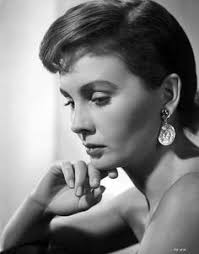 jean simmons close up portrait in shoulder dress and coin earrings wit star news