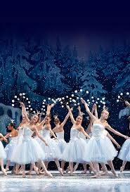 miami city ballet presents george balanchine s the nuter ballerinas dressed in white in a snowy forest holding snow on sticks