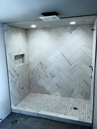 beautiful herringbone marble tiled shower