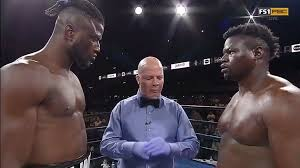 Heavyweight boxer Curtis Harper walks out of the ring after opening bell -  The Ring