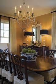 beautiful clic dining room textured wallpaper black accents a great chandelier makes the room