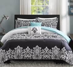 dark grey fl pattern bed aqua blue pillow metallic modern bedlamp grey wall white transpa curtain owl painting fur rug