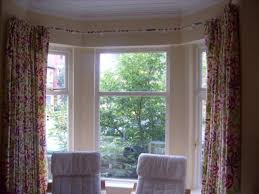 uncategorized hanging curtains in bay window elegant inside how to hang a decorations 18