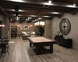 basement design ideas. industrial look-out basement in atlanta with brown walls, medium hardwood floors, no design ideas