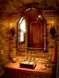 impressive old world bathroom design with brick stone wall and artistic black frame wall mirror also wooden vanity decor idea