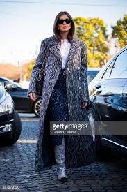 chanel glitter boots. darja barannik wearing a grey coat chanel glitter boots bag and dress is