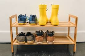 Four pairs of shoes sitting on our runner-up pick for best shoe rack,