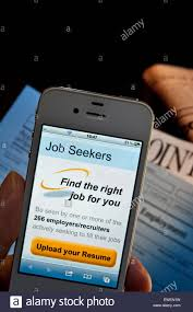 hand holding iphone job seekers cv upload screen app hand holding iphone job seekers cv upload screen app employment forms and newspaper appointments
