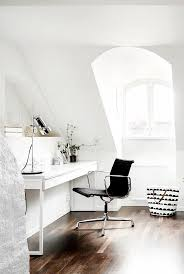 view in gallery office area beside a beautiful and bright attic window beautiful bright office