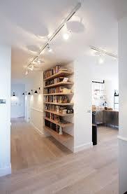 Bookshelf Lighting I Love The Wall Lights And Interesting Use Os Shelves Rather