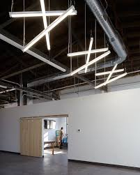 industrial lighting design. unique lighting design helped to break up the space of this vast industrial building