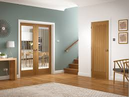 suffolk internal oak rebated door pair with clear etched glass lifestyle roomshot