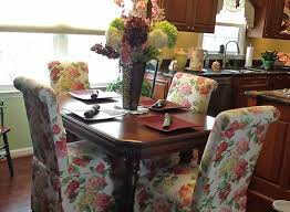 these skirted parsons chairs in ruby alabaster look right at home around this customer s table which has been in her family for 120 years