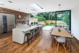 view in gallery herringbone pattern flooring and brick wall backsplash in the modern kitchen design concept 8