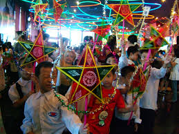 chinese culture writework en viet se children celebrating mid autumn festival in a traditional lantern procession
