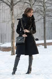 sydne style new york fashion week street style black and gold trend karen millen black coat dress winter new york