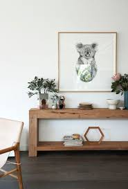 A beautifully chunky Mark Tuckey console table is filled with ceramics by  Marmouset Found and Studio