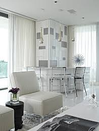 apogee large trendy l shaped seated home bar photo in miami with white cabinets and concrete awesome white brown wood